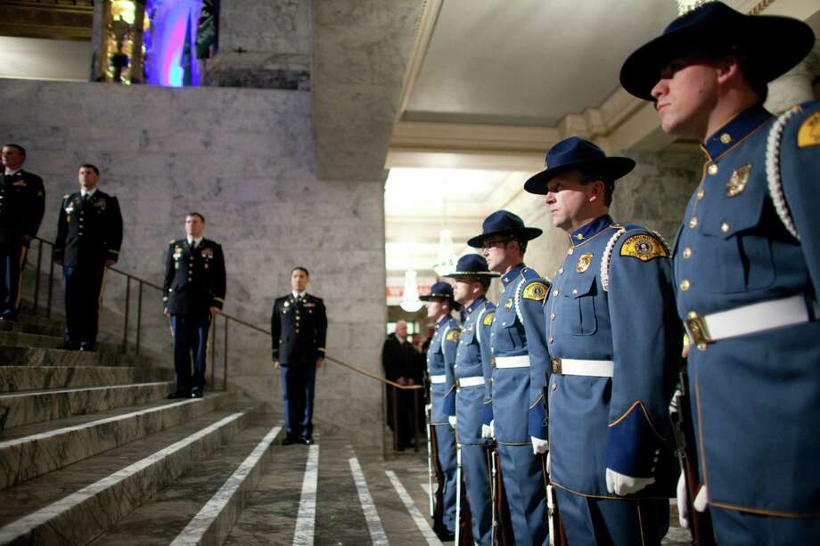 Washington State Patrol officers stand at attention during the Governor's Ball on Wednesday, January 16, 2013 in the rotunda of the State Capitol building. Photo: JOSHUA TRUJILLO, SEATTLEPI.COM / SEATTLEPI.COM
