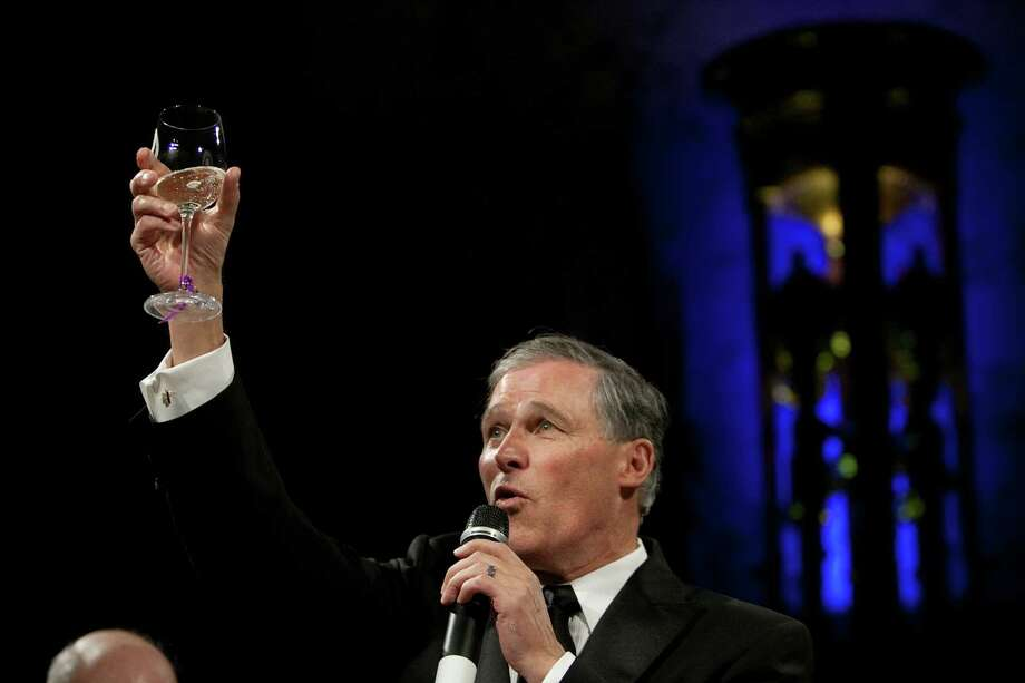 Washington State Governor Jay Inslee offers a toast during the Governor's Ball on Wednesday, January 16, 2013 in the rotunda of the State Capitol building. Photo: JOSHUA TRUJILLO, SEATTLEPI.COM / SEATTLEPI.COM