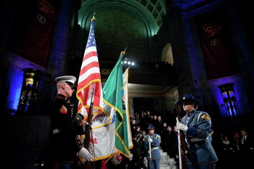 A U.S. military color guard prepares to present the colors during the presentation of Governor Jay I