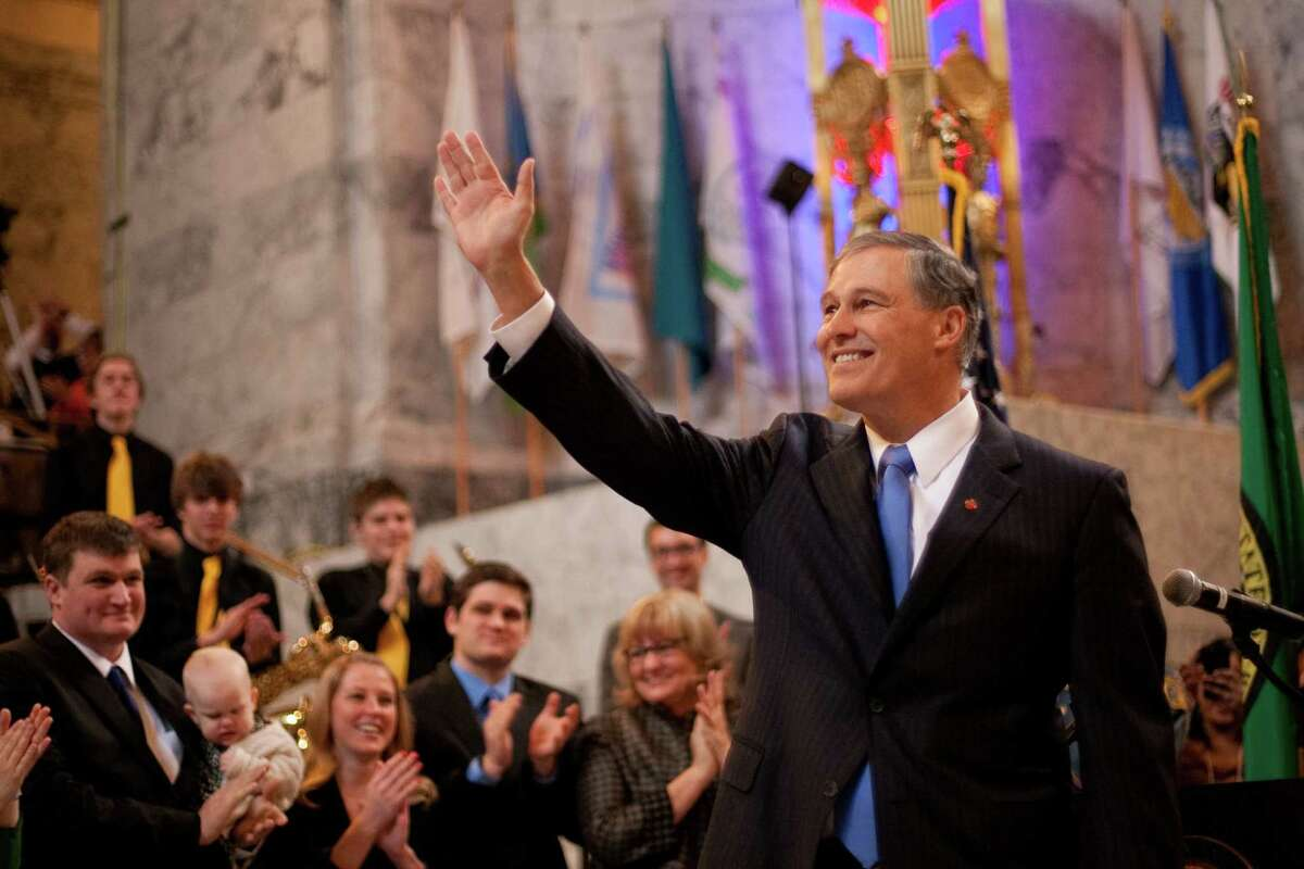 Washington State Governor Jay Inslee waves after he was sworn in as governor on Wednesday, January 16, 2013 in the rotunda of the State Capitol building.