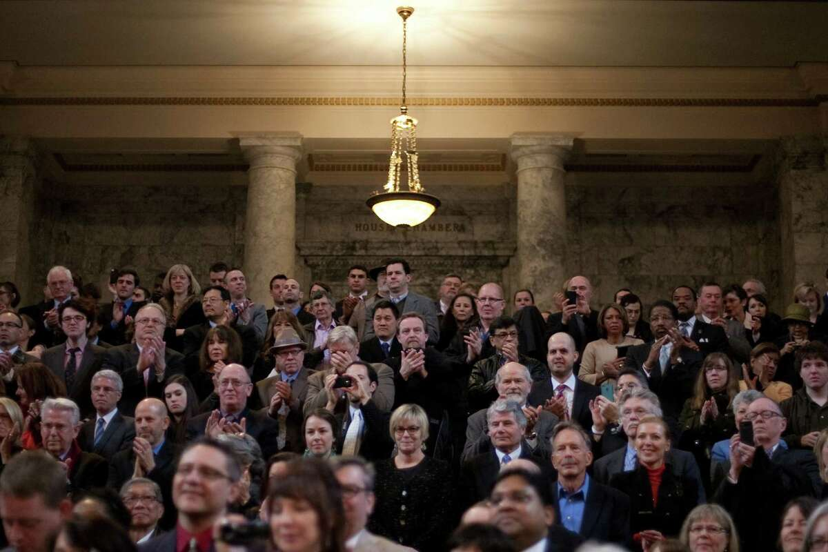 Spectators applaud during the inauguration of Washington State Governor Jay Inslee in the rotunda of the State Capitol building.