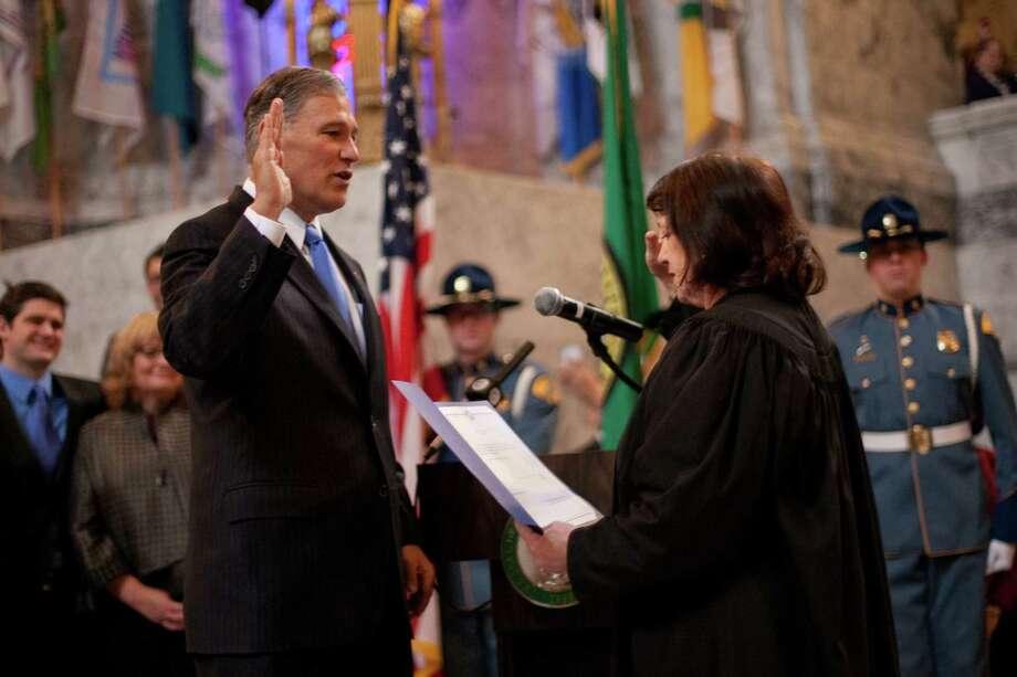 Washington State Governor Jay Inslee takes the oath of office. Photo: JOSHUA TRUJILLO, SEATTLEPI.COM / SEATTLEPI.COM