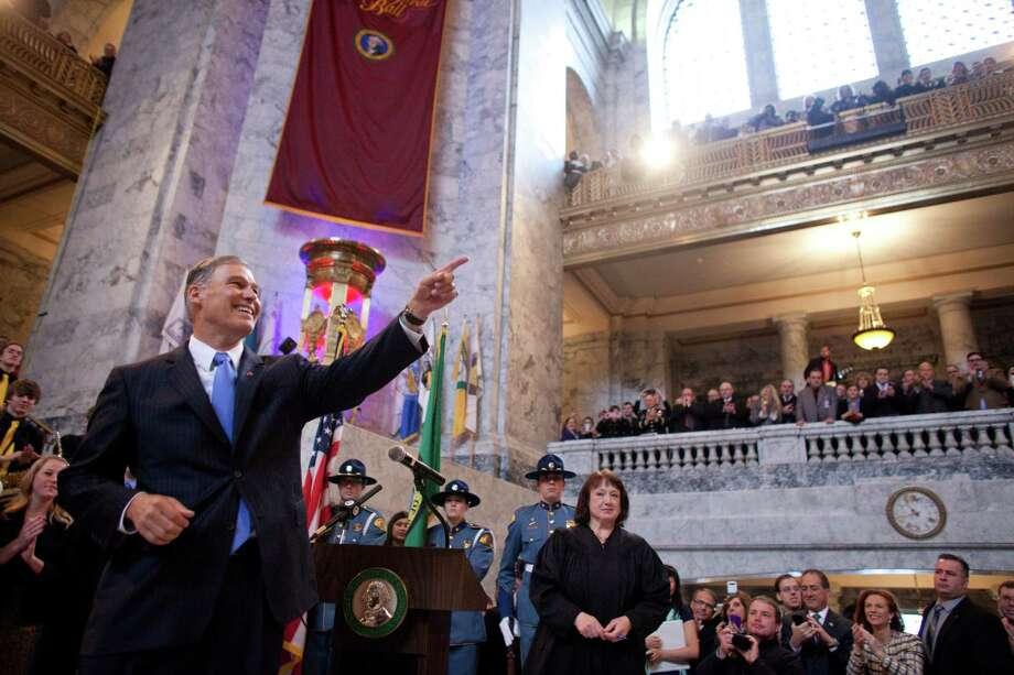 Washington State Governor Jay Inslee addresses people gathered during his inauguration. Photo: JOSHUA TRUJILLO, SEATTLEPI.COM / SEATTLEPI.COM