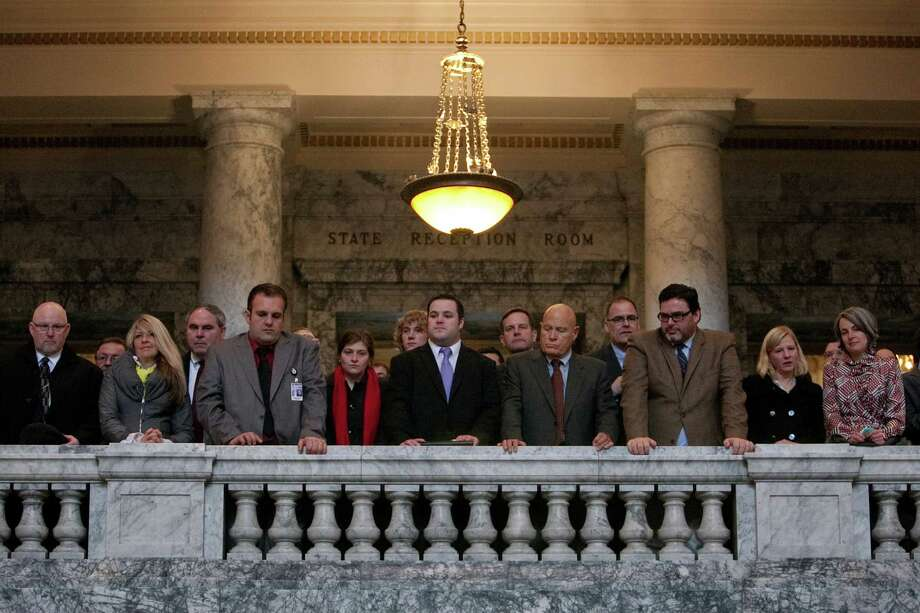 Spectators watch during the inauguration of Washington State Governor Jay Inslee. Photo: JOSHUA TRUJILLO, SEATTLEPI.COM / SEATTLEPI.COM