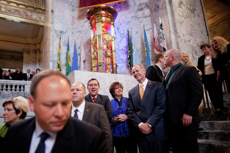 Legislators gather during the inauguration of Washington State Governor Jay Inslee on Wednesday, January 16, 2013 in the rotunda of the State Capitol building. Photo: JOSHUA TRUJILLO, SEATTLEPI.COM / SEATTLEPI.COM