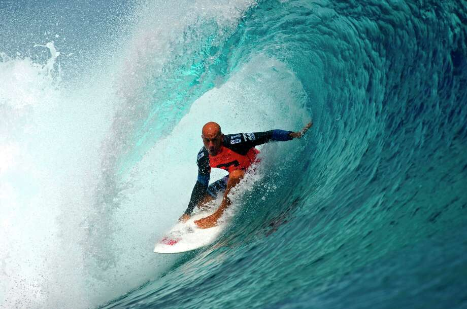 In this image provided by the Association of Surfing Professionals, United States' Kelly Slater rides a surf during round three of the Billabong Pro surfing competition in Tahiti, Sunday, Aug. 26, 2012. He was eliminated and defeated by Brazilian wildcard Ricardo Dos Santos. Photo: Steve Robertson, Associated Press / Association of Surfing Professio