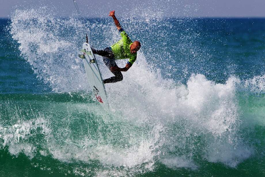 Kelly Slater competes on his way to winning his first round heat at the Hurley Pro surfing event, Sunday, Sept. 16, 2012, in San Clemente, Calif. Photo: Sean Rowland, Associated Press / Association of Surfing Professio