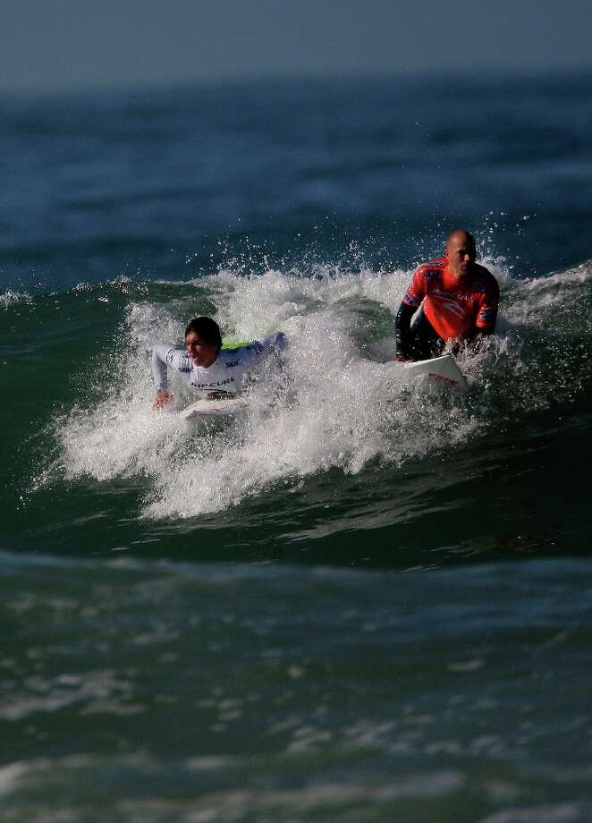 Gabriel Medina of Brazil and Kelly Slater of the USA are seen on a wave during the quarter finals of the Rip Curl Pro Search surfing competition at Ocean Beach on Monday, November 7, 2011 in San Francisco, Calif.  Medina won the Rip Curl Pro Search 2011 competition. Photo: Lea Suzuki, The Chronicle / SFC