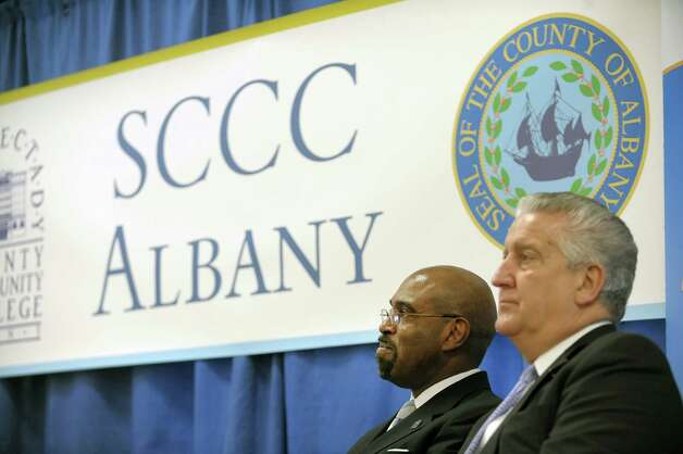 Quintin Bullock, left, president of SCCC and Albany Mayor Jerry Jennings take part in an event at the Albany County office building at 112 State St. on Thursday, Jan. 17, 2013 in Albany, NY.  The event was held to announce a new partnership between the county and Schenectady County Community College to create a classroom space for SCCC's new downtown Albany location.  The college will use space on the second floor of the county office building for classrooms.   (Paul Buckowski / Times Union) Photo: Paul Buckowski  / 00020810A