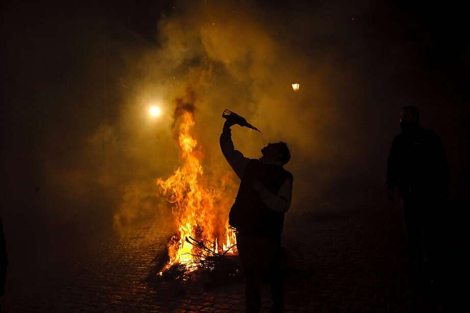 One more bottle and I'm good to go: A little liquid courage can't hurt if you're going to ride your horse into a bonfire. (Saint Anthony's Eve, San Bartolome de Pinares, Spain.) Photo: Daniel Ochoa De Olza, Associated Press
