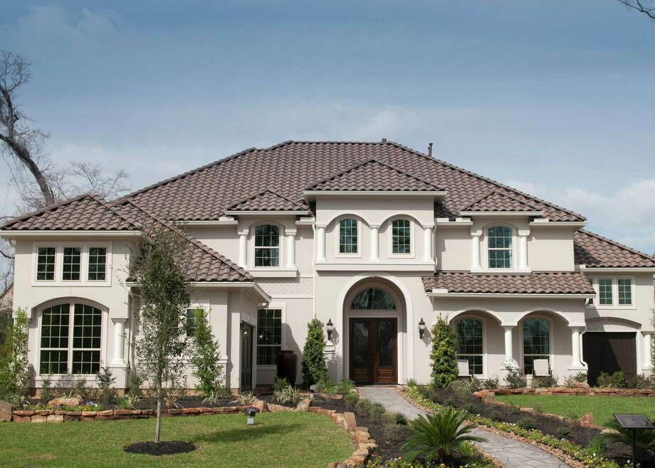 Toll Brothers presents the Vallagio in The Woodlands' neighborhood of Paloma Pines in the Village of Creekside Park. This two-story home includes 5,285 square feet and is priced from $559,995. Photo: Ted Washington / Copyright©Ted Washington