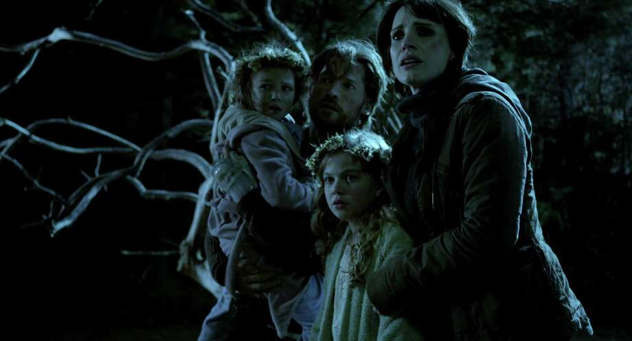 "This film image released by Universal Pictures shows, from left, Isabelle Nelisse, Nikolaj Coster-Waldau, Megan Charpentier and Jessica Chastain in a scene from ""Mama."" (AP Photo/Universal Pictures)"