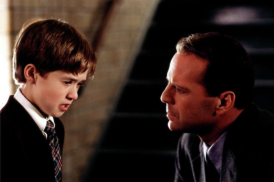 "Haley Joel Osment and Bruce Willis in ""The Sixth Sense."""