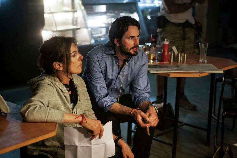 "This undated publicity photo released by Columbia Pictures Industries, Inc. shows Director/Producer, Kathryn Bigelow, left, and Writer/Producer, Mark Boal, on the set of Columbia Pictures' thriller, ""Zero Dark Thirty."" The makers of ""Zero Dark Thirty"" say authenticity was paramount every step of the way as they received insider access to tell the sweeping, meticulously detailed story of the decade-long search for Osama bin Laden. (AP Photo/Columbia Pictures Industries, Inc., Jonathan Olley) Photo: Jonathan Olley"