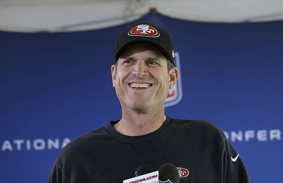 Jim Harbaugh, left, coach of the San Francisco 49ers, and John Harbaugh, coach of the Baltimore Ravens, meet with reporters Wednesday. If both win Sunday, their teams will meet in the Super Bowl in New Orleans on Feb. 3. Photo: Jeff Chiu, Associated Press