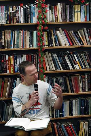 Stephen Elliott, founder of the literary website Rumpus, reads at Adobe Books in the Mission District. Photo: Carlos Avila Gonzalez, The Chronicle