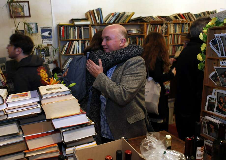 Andrew McKinley gets a hug from Kristina Kearns at Adobe Bookshop in San Francisco, Calif., on Wednesday, January 16, 2013. Adobe is going out of business, and three great SF writers -- Stephen Elliott, Rebecca Solnit and Michelle Tea -- participated in a reading in the store as a kind of farewell on Wednesday, January 16, 2013. Photo: Carlos Avila Gonzalez, The Chronicle