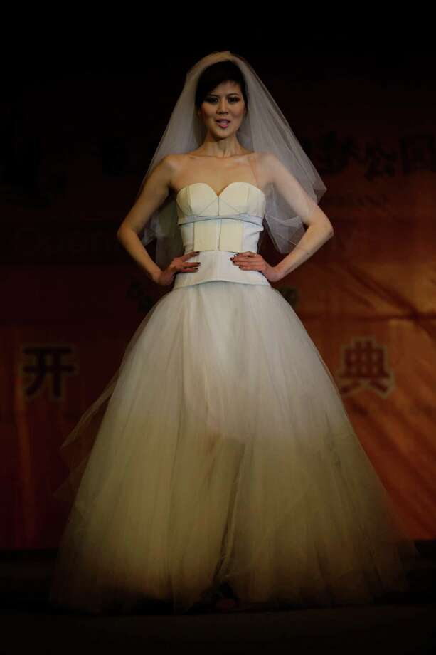 A model shows a wedding dress partially made of chocolate during a chocolate fashion show in Shanghai. Photo: Eugene Hoshiko, Associated Press / AP