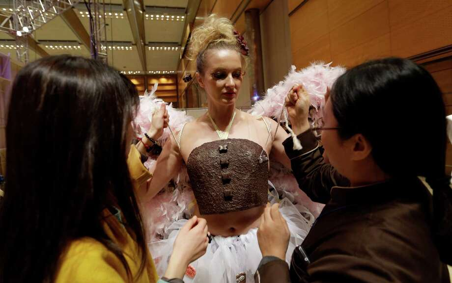 South Korean chocolatier Cho Mi-sun, right, and designer Choi Moon-sun adjusts a model's outfit before a chocolate fashion show in Seoul. Photo: Lee Jin-man, Associated Press / AP