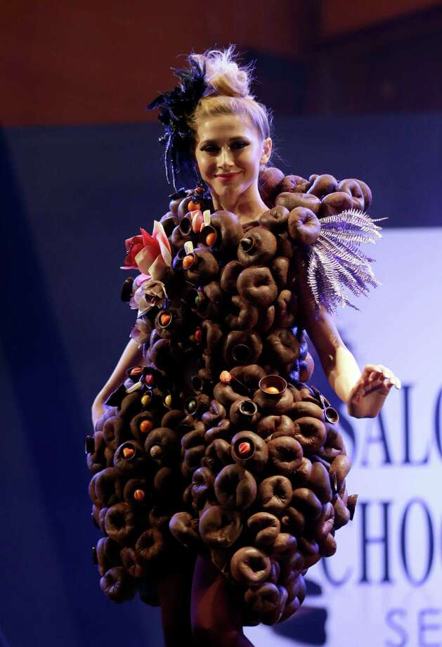 A model displays an outfit partially made of chocolate during chocolate fashion show in Seoul. Photo: Lee Jin-man, Associated Press / AP