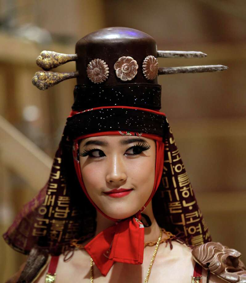 A model displays a traditional Korean outfit partially made of chocolate during chocolate fashion show in Seoul. Photo: Lee Jin-man, Associated Press / AP