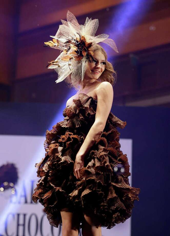 Do you ever have a day when life just seems sweeter? That was probably  the case in Shanghai and Seoul, South Korea this week, as both cities  played host to chocolate fashion shows. Models walked the runways  Thursday in chocolate hats, chocolate dresses and chocolate bustiers.  See if you can make it through the slideshow without getting a craving.A model displays an outfit partially made of chocolate during chocolate fashion show in Seoul. Photo: Lee Jin-man, Associated Press / AP