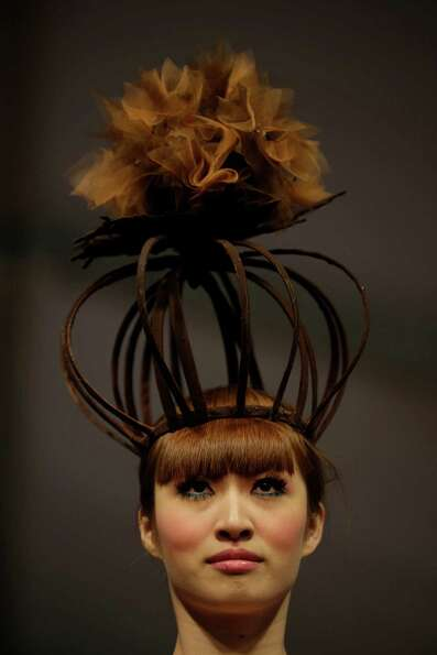 A model shows off a crown partially made of chocolate during a chocolate fashion show in Shanghai.