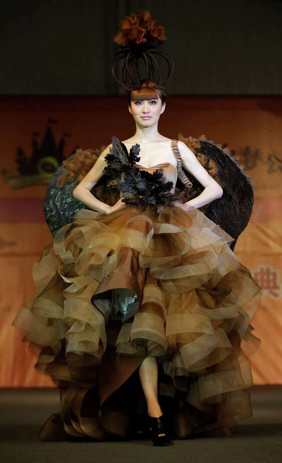 A model displays a dress partially made of chocolate during a chocolate fashion show in Shanghai. Photo: Eugene Hoshiko, Associated Press / AP