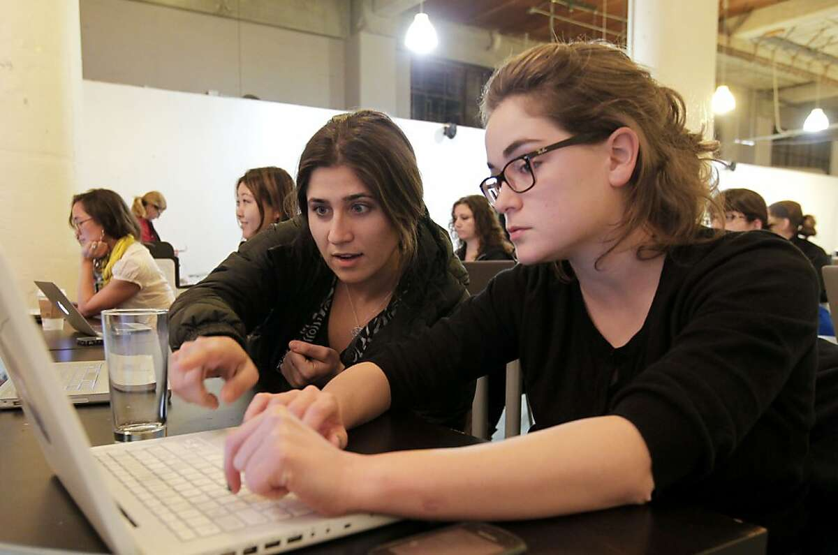 Alyssa Ravasid, (left) and Julie Dequaire collaborate during class as women attend a seminar on the Introduction to Javascript Workshop at the Citizen Space on Second St. on Thursday Jan. 10, 2013, in San Francisco, Calif. Girl Develop It San Francisco sponsors the meet-up workshops directly focused on woman.