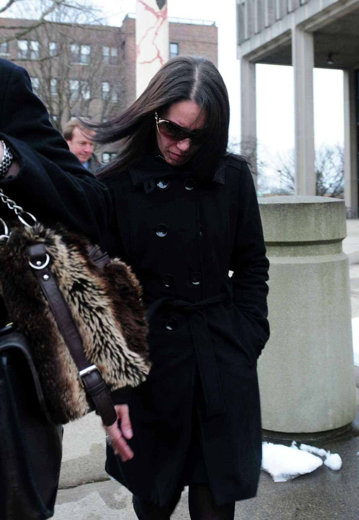Nouel Alba leaves the federal courthouse in Bridgeport, Conn. Thursday, Jan. 17, 2013 after pleading not guilty to scamming donors who wished to contribute to the funeral costs of Noah Pozner, a 6-year-old victim of the Newtown shooting.