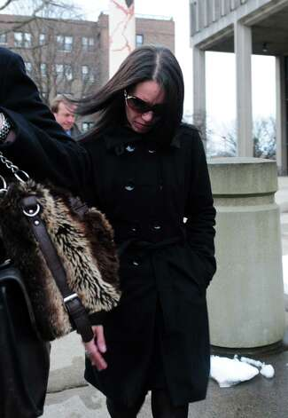 Nouel Alba leaves the federal courthouse in Bridgeport, Conn. Thursday, Jan. 17, 2013 after pleading not guilty to scamming donors who wished to contribute to the funeral costs of Noah Pozner, a 6-year-old victim of the Newtown shooting. Photo: Autumn Driscoll / Connecticut Post