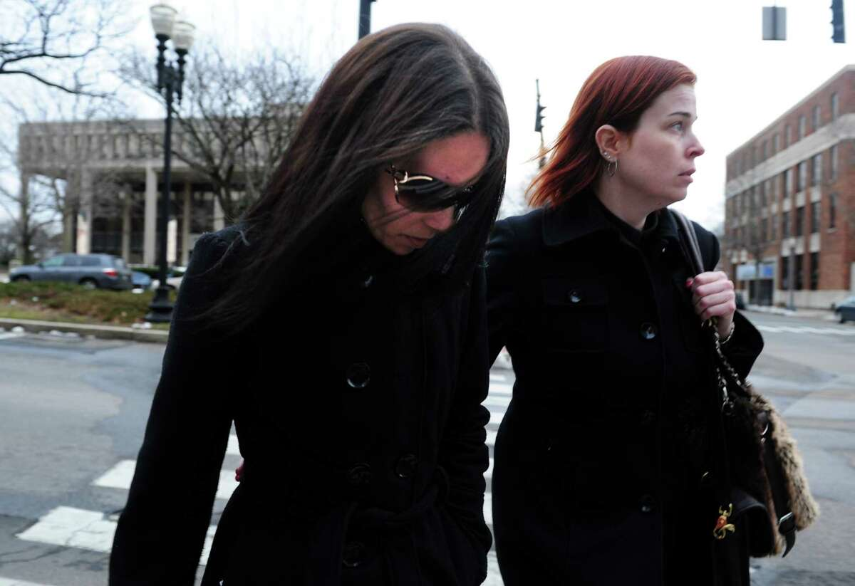 Nouel Alba, left, leaves the federal courthouse in Bridgeport, Conn. Thursday, Jan. 17, 2013 after pleading not guilty to scamming donors who wished to contribute to the funeral costs of Noah Pozner, a 6-year-old victim of the Newtown shooting.
