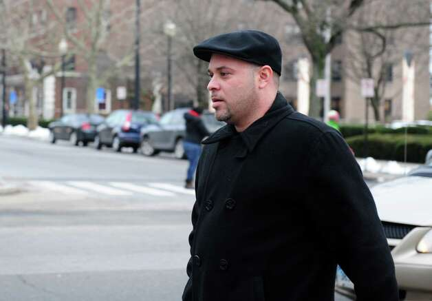 Alfredo Alba, brother of Nouel Alba, leaves the federal courthouse in Bridgeport, Conn. Thursday, Jan. 17, 2013 after his sister entered a not guilty plea to scamming donors who wished to contribute to the funeral costs of Noah Pozner, a 6-year-old victim of the Newtown shooting. Photo: Autumn Driscoll / Connecticut Post
