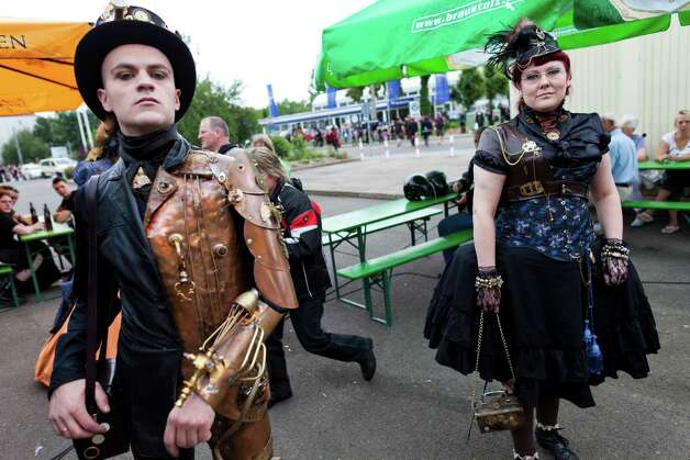Gothic rock music enthusiasts in steampunk walk the streets between venues during the annual Wave Gotik music festival on June 11, 2011 in Leipzig, Germany. (Carsten Koall/Getty Images) Photo: Carsten Koall, Multiple / 2011 Getty Images