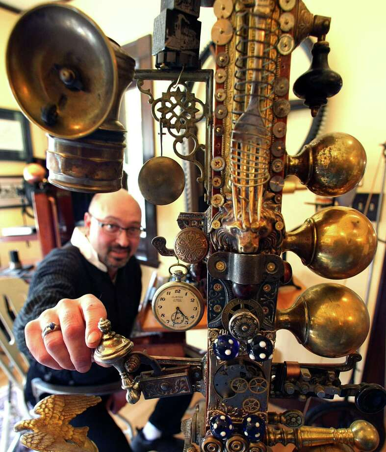 At the steampunk decorated home of Bruce and Melanie Rosenbaum, a contraption he designed includes knobs, a fork, a watch. (John Tlumacki/The Boston Globe via Getty Images) Photo: Multiple