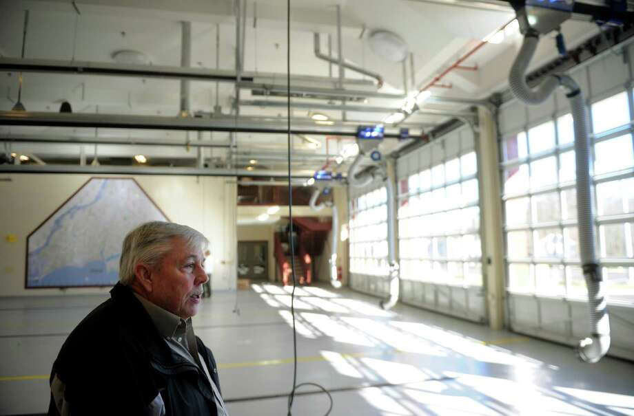 Retired Battalion Chief William Healey stands on the apparatus floor of the new East Side Fire Station in Milford on Thursday, January 10, 2013. Photo: Brian A. Pounds