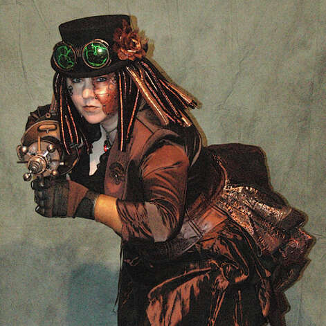 "Diana Vick, vice chair of Steamcon®, dressed in steampunk regalia. Check out the group's main page for more photos and details related to Steamcon and its upcoming events. (R. ""Martin"" Armstrong) Photo: Multiple"