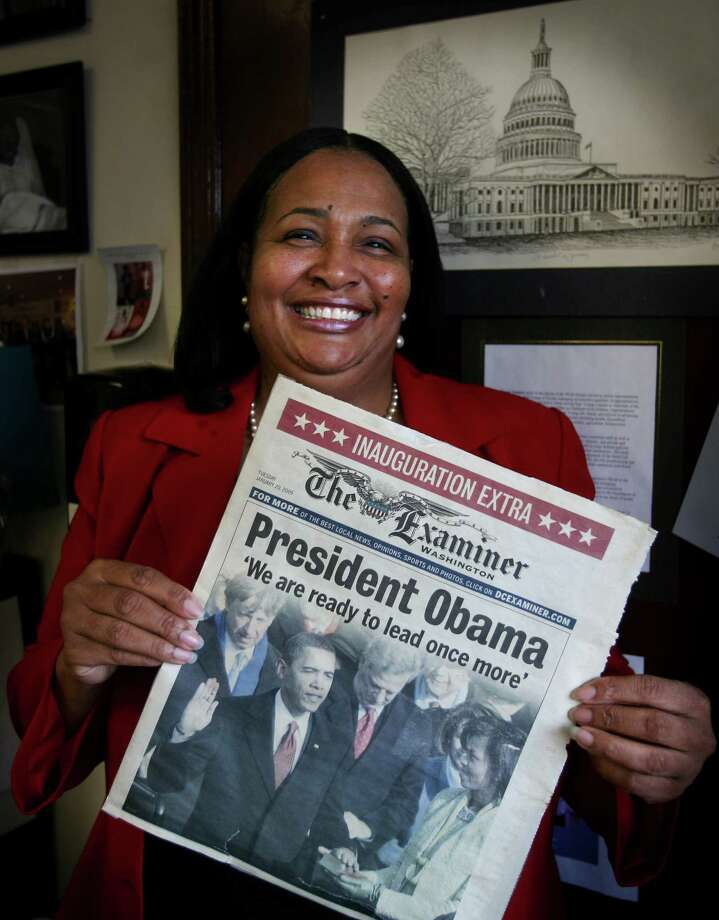 NAACP Greater Bridgeport Branch President Carolyn Vermont, who will be attending the Obama inauguration on January 21, holds a Washington newspaper from his first inauguration that she attended in 2009, at ABCD in Bridgeport on Thursday, January 17, 2013. Photo: Brian A. Pounds / Connecticut Post