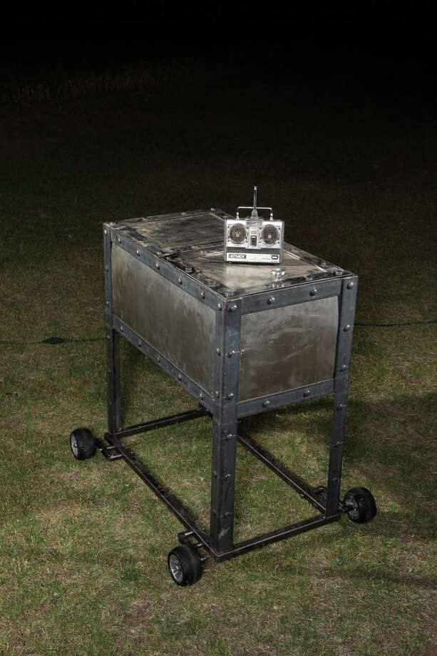 Lance Greathouse's Backyard Barbeque. Greathouse decked out a standard cooler in steampunk-inspired metal panels and rivets and added wheels, the motor from one of his old robots, and an R/C car controller so he can drive it from afar. Using the controller, he can steer the cooler over to a friend, open the lid, and offer a beverage. (John B. Carnett/Bonnier Corp. via Getty Images) Photo: John B. Carnett, Multiple / Bonnier Corporation