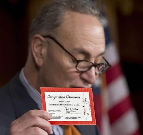 This photo taken Jan. 14,  2013 shows Sen. Charles Schumer, D-N.Y., chairman of the Joint Congressional Committee on Inaugural Ceremonies, holding an inaugural ticket during a news conference on Capitol Hill in Washington. Schumer's office announced Thursday that eBay and Craigslist agreed to cancel the listings. The office said the StubHub website had already refused to sell Inaugural tickets.  (AP Photo/J. Scott Applewhite) Photo: J. Scott Applewhite, Associated Press
