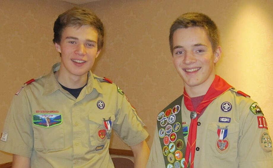 David Maughan of Schodack, left, and his cousin Craig Maughan of Burnt Hills, right, recently achieved the rank of Eagle Scout and shared a joint Eagle Court of Honor. (Courtesy Maughan  family)