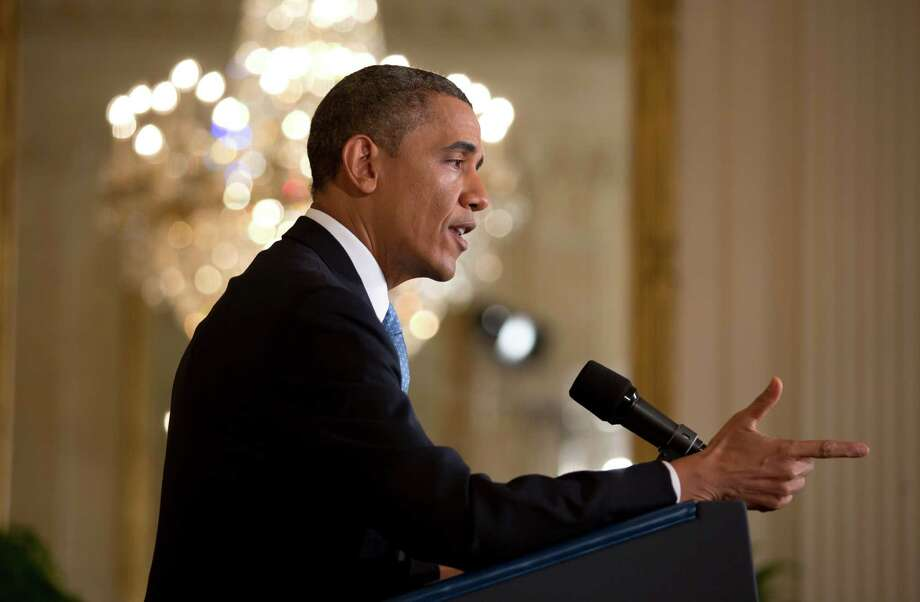 "President Barack Obama speaks at a new conference in the East Room of the White House, in Washington, Jan. 14, 2013. Obama warned Republicans on Monday against refusing to raise the nation's debt ceiling, calling such talk ""irresponsible"" and saying it would set off an economic crisis. Photo: STEPHEN CROWLEY, New York Times / NYTNS"
