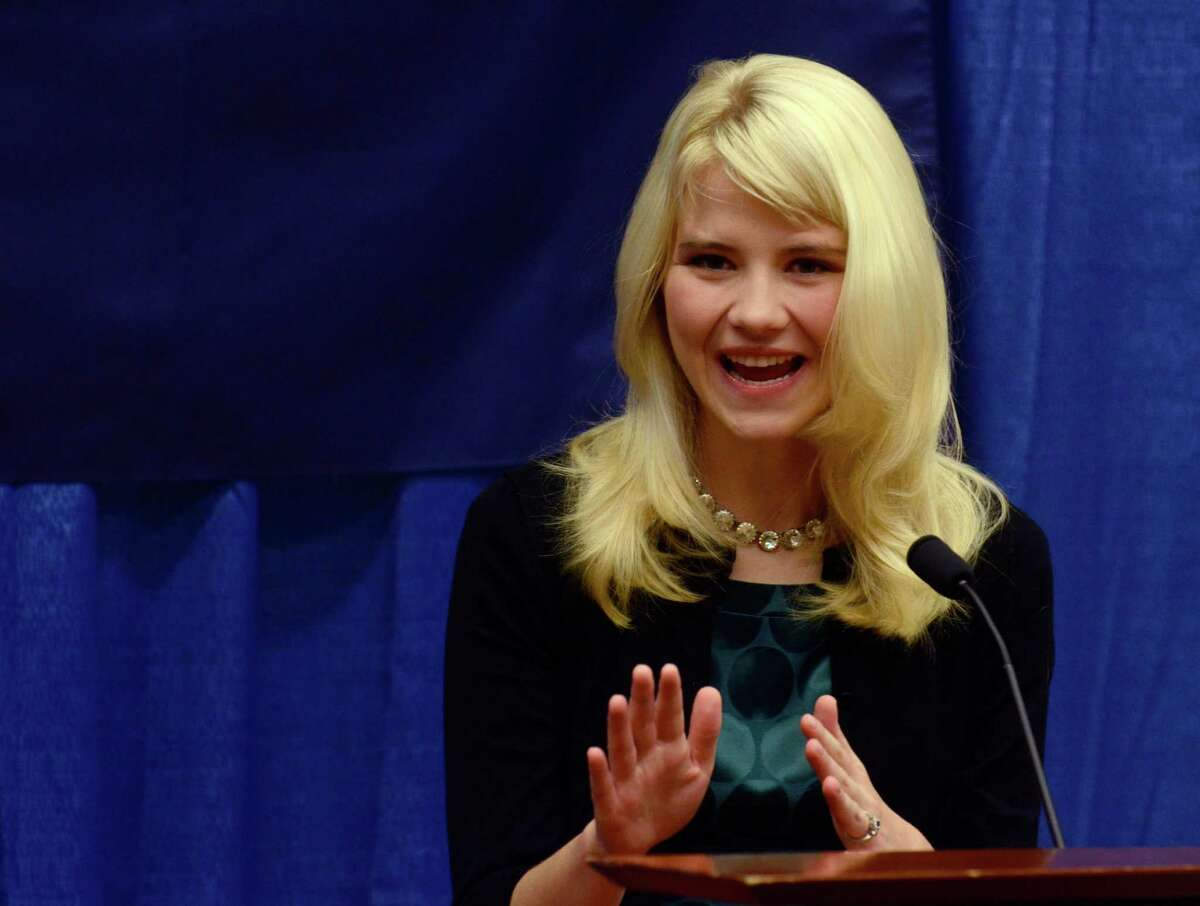 Elizabeth Smart speaks to reporters regarding her advocacy of child protection and the healing process she has experienced, prior to her presentation at the Child Sexual Abuse Conference, Tuesday, Oct. 30, 2012, in State College, Pa. Smart was abducted in 2002 and held prisoner for nine months before being reunited with her family. (AP Photo/Ralph Wilson)
