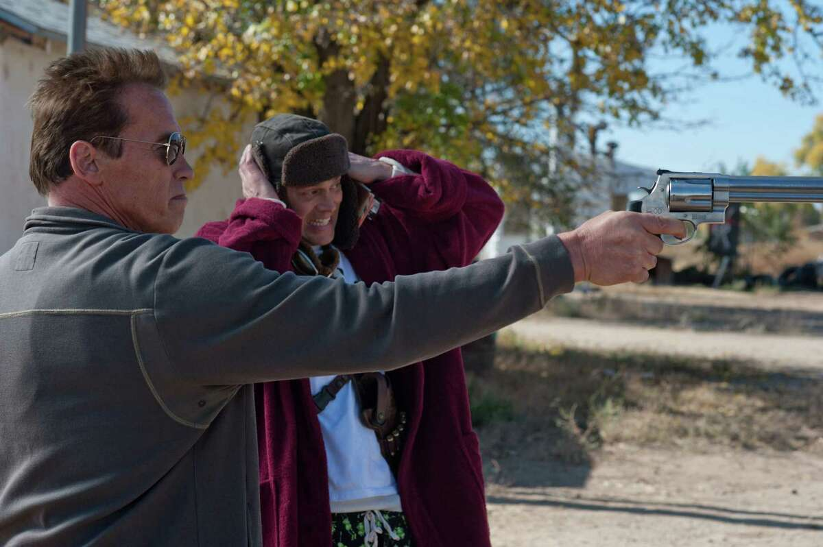 Sheriff Owen (Arnold Schwarzenegger, left) and his assistant (Johnny Knoxville) battle a drug cartel in
