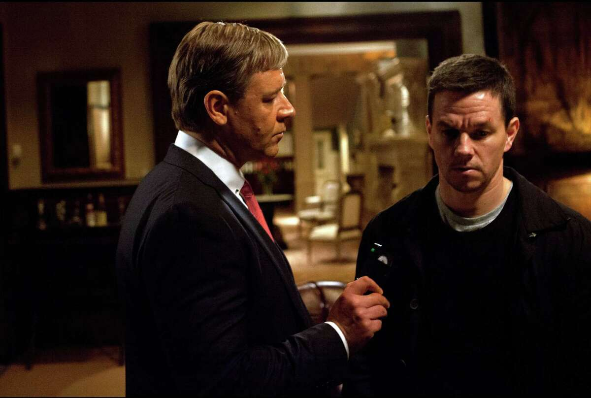 This film image released by 20th Century Fox shows Russell Crowe, left, and Mark Wahlberg in a scene from