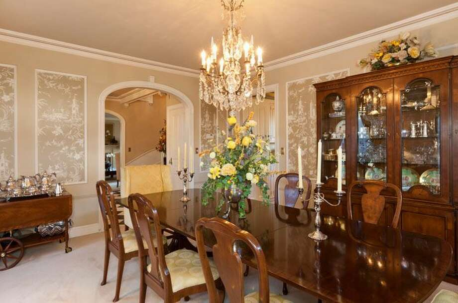 Dining room of 1323 Willard Ave. W. The 5,290-square-foot brick colonial, built in 1928, has five bedrooms, 4.75 bathrooms, marble floors, radiators, a family room, a bar and expansive views on a terraced, 9,778-square-foot lot. It's listed for $2.598 million. Photo: Courtesy Carol Ard/Windermere Real Estate