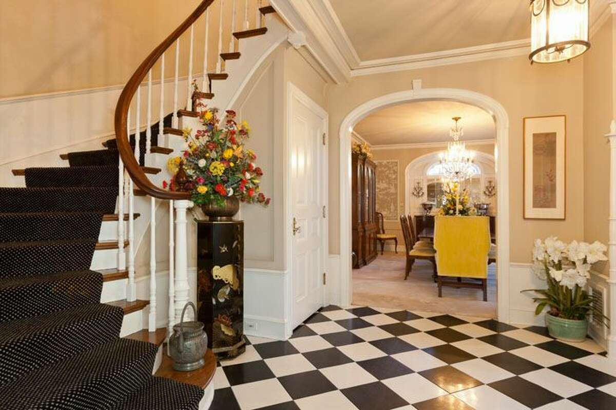 Entry of 1323 Willard Ave. W. The 5,290-square-foot brick colonial, built in 1928, has five bedrooms, 4.75 bathrooms, marble floors, radiators, a family room, a bar and expansive views on a terraced, 9,778-square-foot lot. It's listed for $2.598 million.