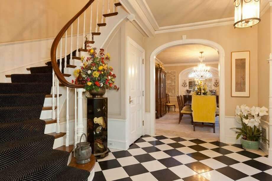 Entry of 1323 Willard Ave. W. The 5,290-square-foot brick colonial, built in 1928, has five bedrooms, 4.75 bathrooms, marble floors, radiators, a family room, a bar and expansive views on a terraced, 9,778-square-foot lot. It's listed for $2.598 million. Photo: Courtesy Carol Ard/Windermere Real Estate