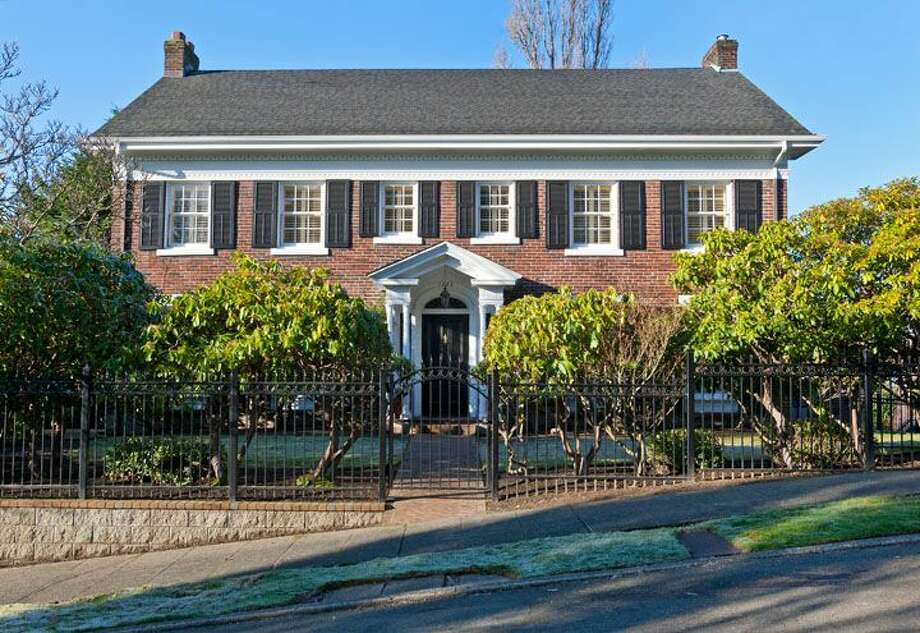 Here's a Queen Anne brick colonial mansion that would fit in fine on the East Coast. The house, 1323 Willard Ave. W., was built in 1928, but has been extensively remodeled. It's 5,290 square feet, with five bedrooms, 4.75 bathrooms, marble floors, radiators, a family room, a bar and expansive views on a terraced, 9,778-square-foot lot. It's listed for $2.598 million. Photo: Courtesy Carol Ard/Windermere Real Estate
