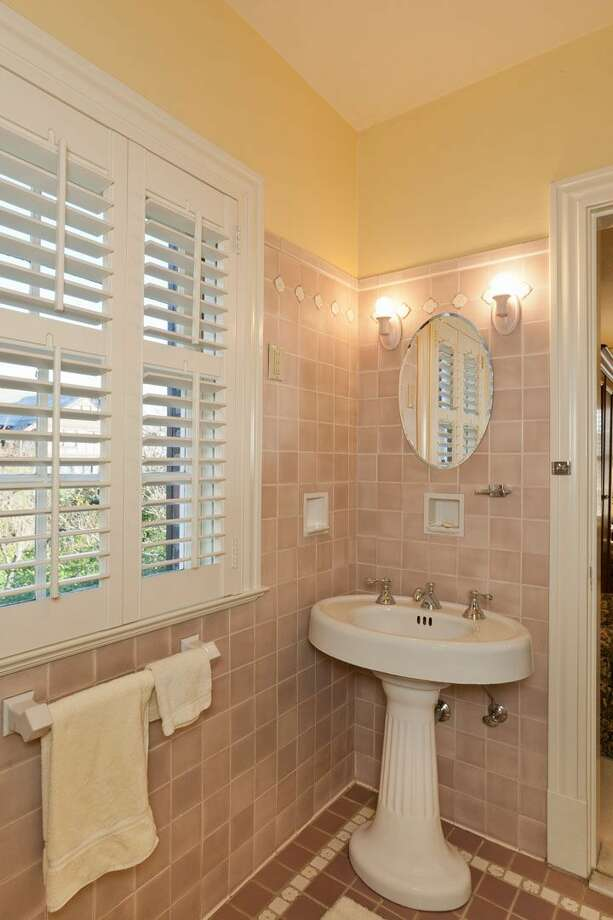 Bedroom suite bathroom of 1323 Willard Ave. W. The 5,290-square-foot brick colonial, built in 1928, has five bedrooms, 4.75 bathrooms, marble floors, radiators, a family room, a bar and expansive views on a terraced, 9,778-square-foot lot. It's listed for $2.598 million. Photo: Courtesy Carol Ard/Windermere Real Estate